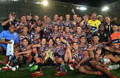 Johnathan Thurston of the Indigenous All Stars and team mates celebrate victory after the NRL preseason match between the Indigenous All Stars and...