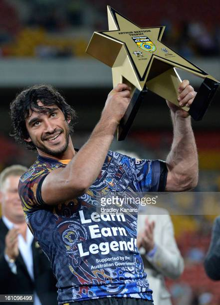 Johnathan Thurston of the Indigenous All Stars celebrates victory as he holds up the Arthur Beetson trophy after the NRL All Stars Game between the...