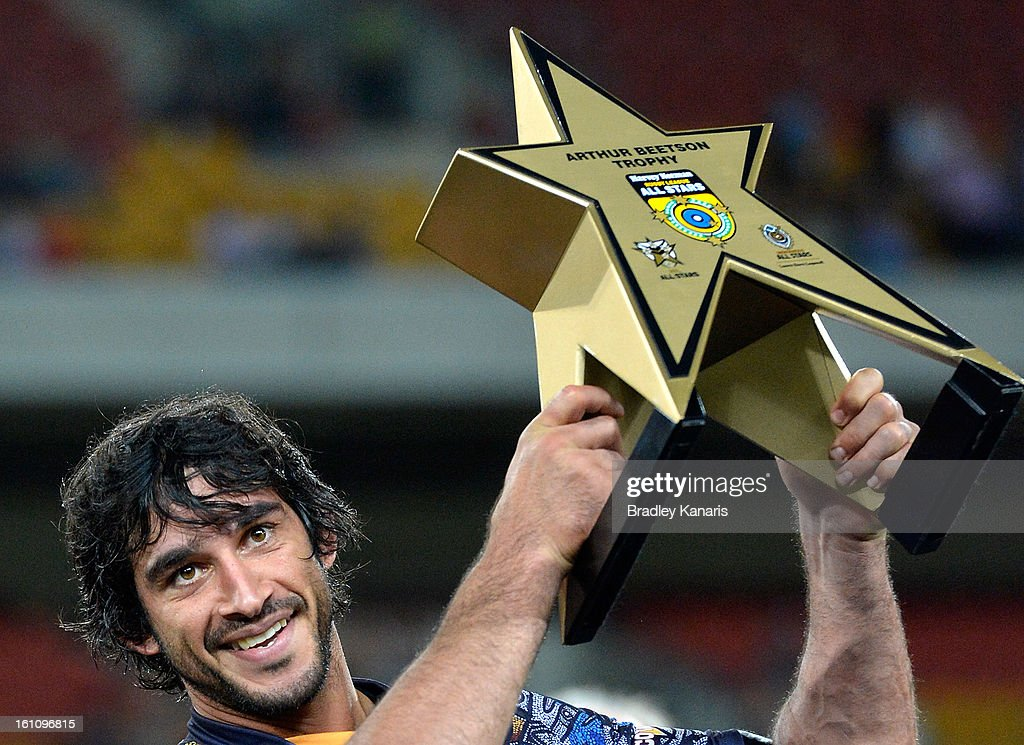 Johnathan Thurston of the Indigenous All Stars holds up the Arthur Beetson Trophy as he celebrates victory after the NRL All Stars Game between the Indigenous All Stars and the NRL All Stars at Suncorp Stadium on February 9, 2013 in Brisbane, Australia.
