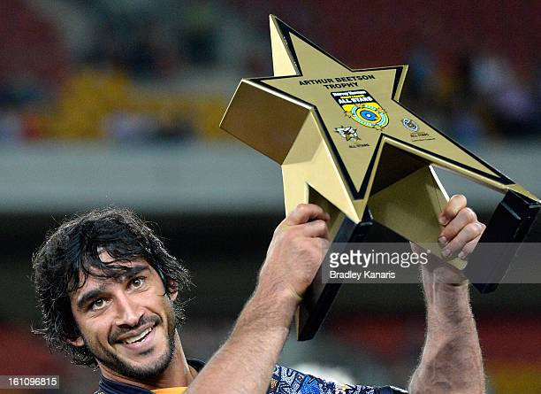 Johnathan Thurston of the Indigenous All Stars holds up the Arthur Beetson Trophy as he celebrates victory after the NRL All Stars Game between the...