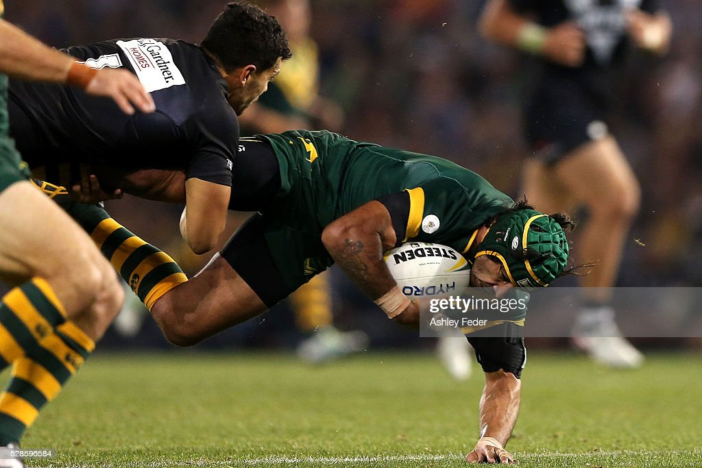 Johnathan Thurston of the Kangaroos is tackled during the International Rugby League Trans Tasman Test match between the Australian Kangaroos and the New Zealand Kiwis at Hunter Stadium on May 6, 2016 in Newcastle, Australia.