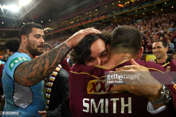 Johnathan Thurston of the Maroons and Cameron Smith of the Maroons embrace after winning game three of the State Of Origin series between the...