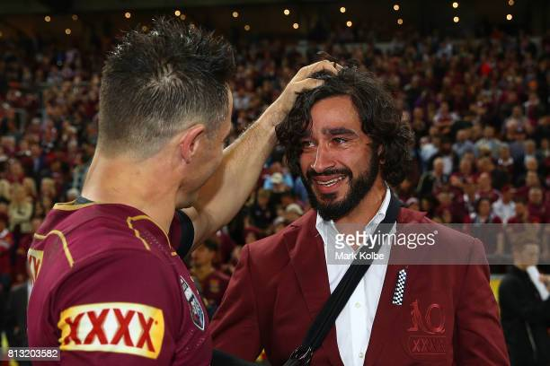 Johnathan Thurston of the Maroons and Cooper Cronk of the Maroons embrace after winning game three of the State Of Origin series between the...