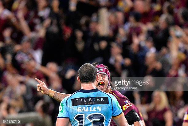 Johnathan Thurston of the Maroons celebrates victory as he yells at Paul Gallen of the Blues during game two of the State Of Origin series between...