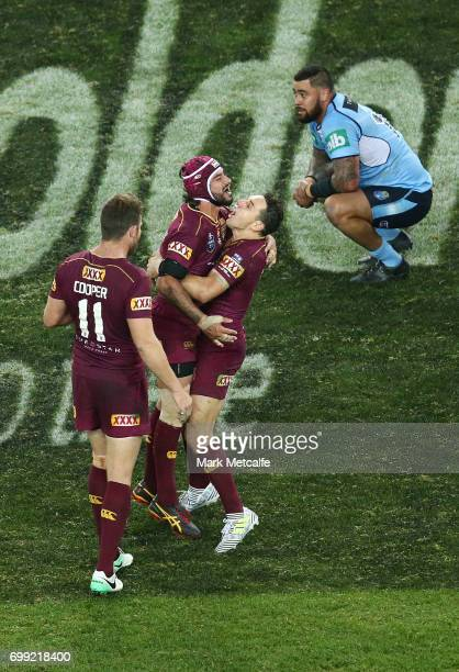 Johnathan Thurston of the Maroons celebrates victory with team mates Billy Slater and Gavin Cooper during game two of the State Of Origin series...