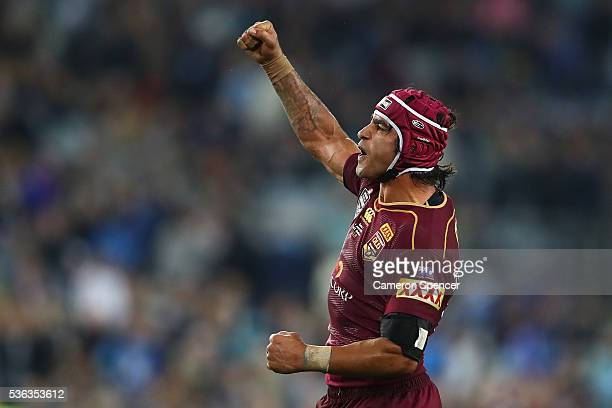 Johnathan Thurston of the Maroons celebrates winning game one of the State Of Origin series between the New South Wales Blues and the Queensland...