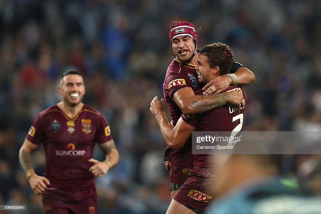 Johnathan Thurston of the Maroons celebrates with team mate Corey Oates after winning game one of the State Of Origin series between the New South Wales Blues and the Queensland Maroons at ANZ Stadium on June 1, 2016 in Sydney, Australia.