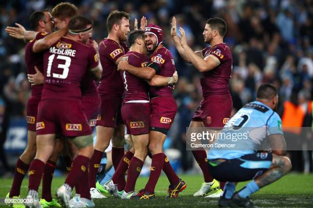 Johnathan Thurston of the Maroons celebrates with team mates after winning game two of the State Of Origin series between the New South Wales Blues...