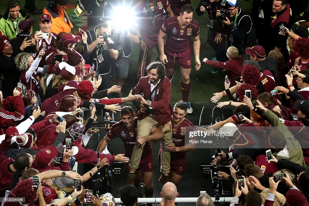 Johnathan Thurston of the Maroons is chaired from the ground after game three of the State Of Origin series between the Queensland Maroons and the New South Wales Blues at Suncorp Stadium on July 12, 2017 in Brisbane, Australia.