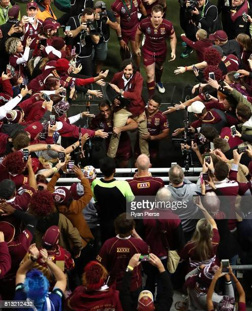 Johnathan Thurston of the Maroons is chaired from the ground after game three of the State Of Origin series between the Queensland Maroons and the...