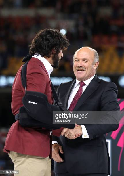 Johnathan Thurston of the Maroons is congratulated by Wally Lewis after game three of the State Of Origin series between the Queensland Maroons and...