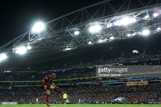 Johnathan Thurston of the Maroons kicks a goal during game two of the State Of Origin series between the New South Wales Blues and the Queensland...