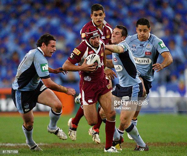 Johnathan Thurston of the Maroons makes a line break to set up a try by Billy Slater during match three of the ARL State of Origin series between the...