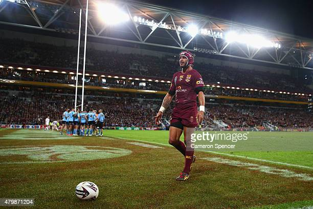 Johnathan Thurston of the Maroons reacts to the crowd after a try by team mate Greg Inglis during game three of the State of Origin series between...