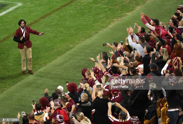 Johnathan Thurston of the Maroons thanks the crowd after game three of the State Of Origin series between the Queensland Maroons and the New South...