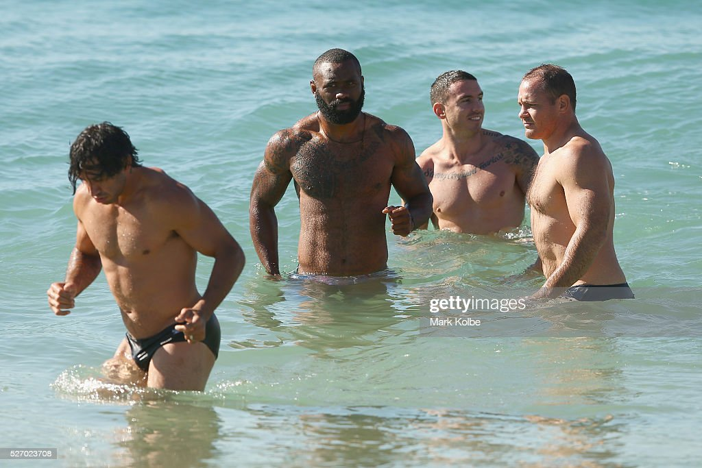 Johnathan Thurston, Semi Radradra, Darius Boyd and Matt Scott walk in the water during the Australia Kangaroos Test team recovery session at Coogee Beach on May 2, 2016 in Sydney, Australia.