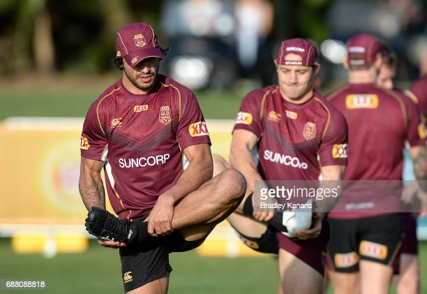 Johnathan Thurston stretches during a Queensland Maroons State of Origin training session at InterContinental Sanctuary Cove Resort Training Field on...