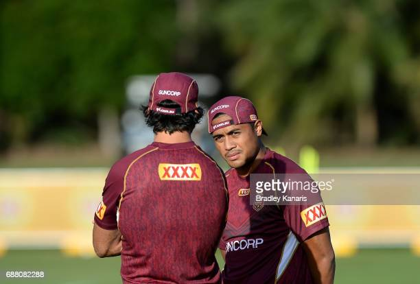 Johnathan Thurston talks tactics with team mate Anthony Milford during a Queensland Maroons State of Origin training session at InterContinental...