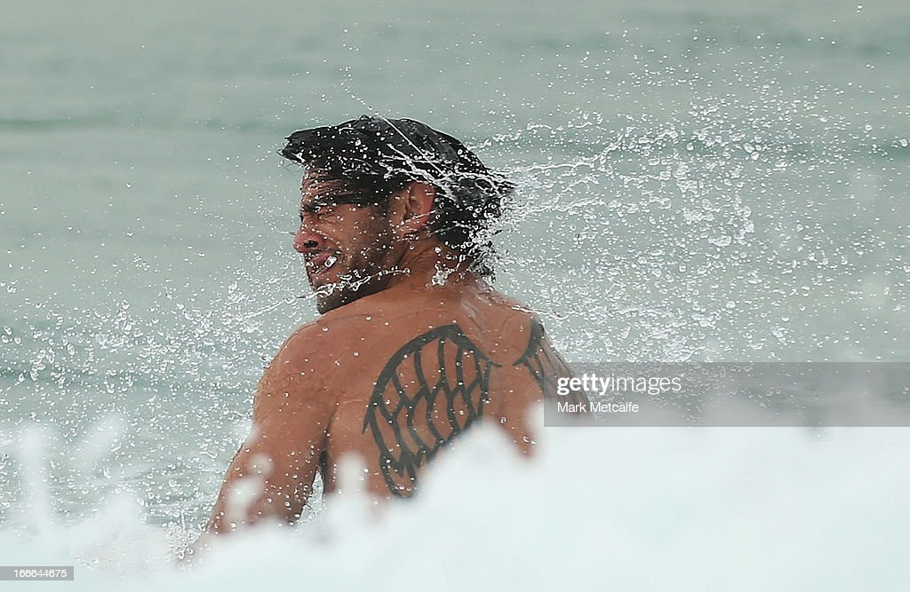 <a gi-track='captionPersonalityLinkClicked' href=/galleries/search?phrase=Johnathan+Thurston&family=editorial&specificpeople=233427 ng-click='$event.stopPropagation()'>Johnathan Thurston</a> wades in the ocean during an Australian Kangaroos training session at Coogee Oval on April 15, 2013 in Sydney, Australia.