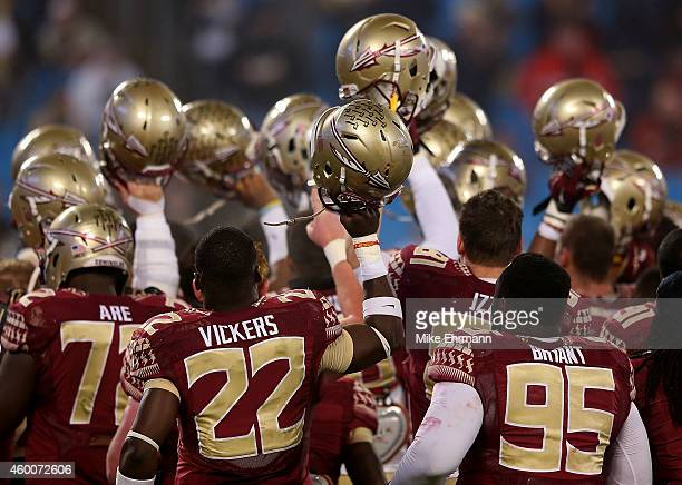 Johnathan Vickers and Keith Bryant of the Florida State Seminoles join a team huddle before the game against the Georgia Tech Yellow Jackets at the...