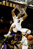 Johnathan Williams III of the Missouri Tigers dunks over Brian Bridgewater of the LSU Tigers during the game at Mizzou Arena on January 8 2015 in...