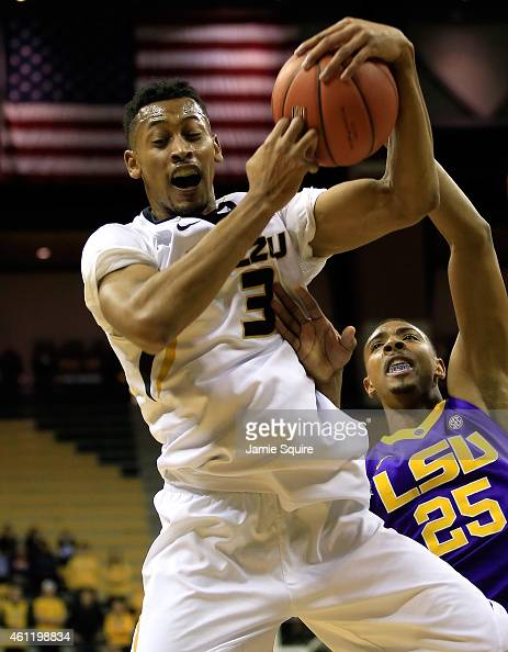 Johnathan Williams III of the Missouri Tigers grabs a rebound over Jordan Mickey of the LSU Tigers during the game at Mizzou Arena on January 8 2015...