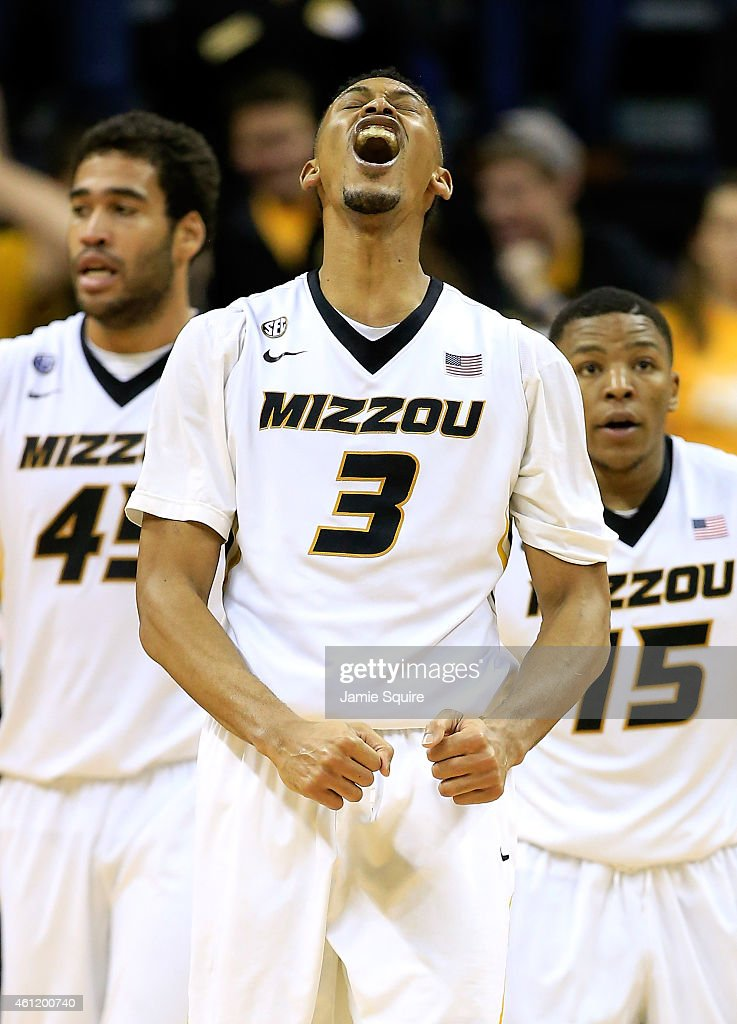 Johnathan Williams III of the Missouri Tigers screams in celebration alongside Keanau Post and Wes Clark as the Tigers defeat the LSU Tigers 7467 to...