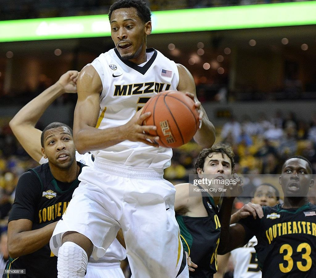 Johnathan Williams of Missouri pulls a rebound away from a trio of Southeastern Louisiana defenders during the first half on Friday, Nov. 8, 2013, at Mizzou Arena in Columbia, Missouri. Missouri won, 89-53.