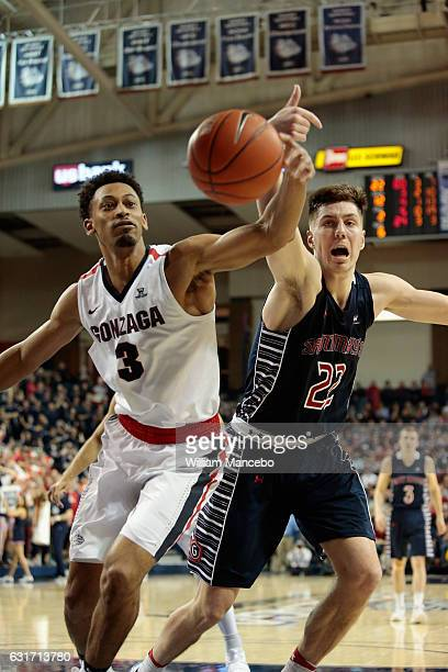 Johnathan Williams of the Gonzaga Bulldogs and Dane Pineau of the Saint Mary's Gaels battle for possession of a loose ball in the second half at...