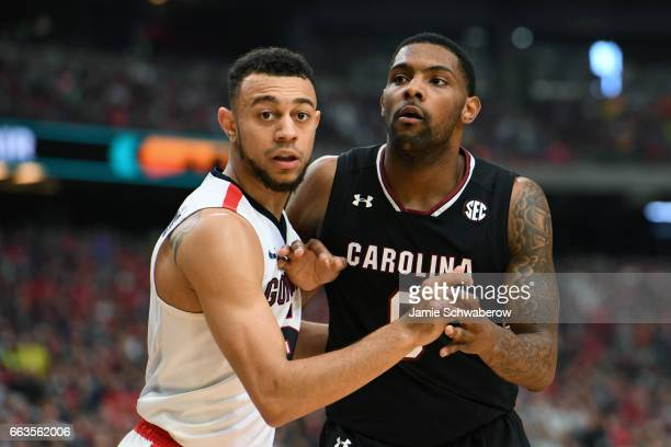 Johnathan Williams of the Gonzaga Bulldogs and Silas Melson of the Gonzaga Bulldogs battel for position during the 2017 NCAA Men's Final Four...
