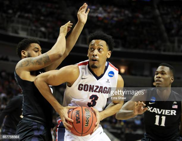 Johnathan Williams of the Gonzaga Bulldogs goes up against Trevon Bluiett and Malcolm Bernard of the Xavier Musketeers in the first half during the...