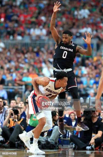 Johnathan Williams of the Gonzaga Bulldogs handles the ball against Sindarius Thornwell of the South Carolina Gamecocks in the second half during the...