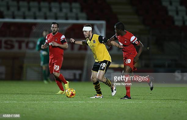 JohnJoe O'Toole of Northampton Town attempts to control the ball watched by Marvin Bartley of Leyton Orient during the Johnstone's Paint Trophy...