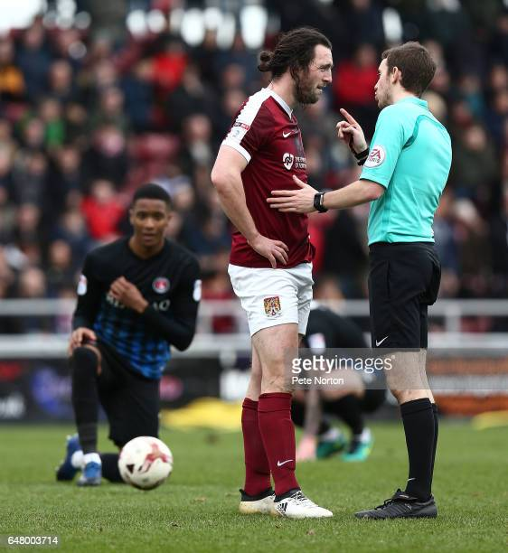 JohnJoe O'Toole of Northampton Town is spoken to by referee Ben Toner during the Sky Bet League One match betweenNorthampton Town and Charlton...