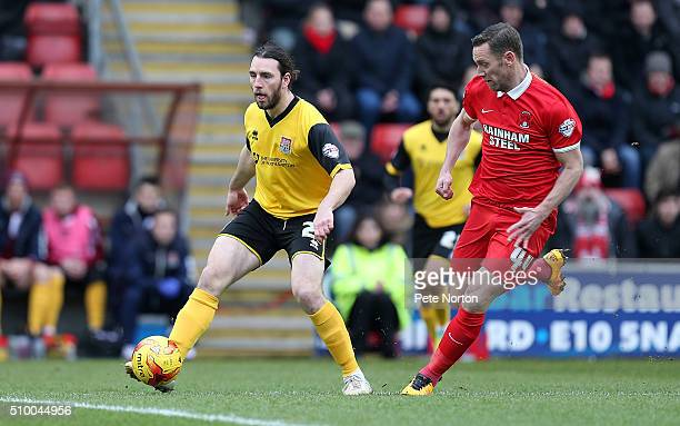 JohnJoe O'Toole of Northampton Town plays the ball watched by Kevin Nolan of Leyton Orient during the Sky Bet League Two match between Leyton Orient...