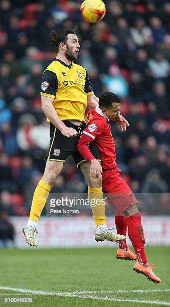 JohnJoe O'Toole of Northampton Town rises above Calaum JahraldoMartin of Leyton Orient to head the ball during the Sky Bet League Two match between...