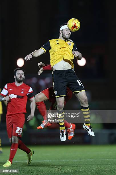JohnJoe O'Toole of Northampton Town rises to head the ball during the Johnstone's Paint Trophy Southern Section Quarter Final match between Leyton...