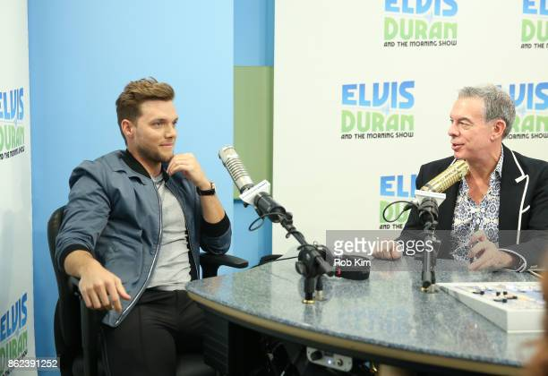 JOHNk with host Elvis Duran during a visit to 'The Elvis Duran Z100 Morning Show' at Z100 Studio on October 17 2017 in New York City
