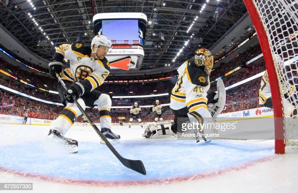 JohnMichael Liles and Tuukka Rask of the Boston Bruins defend their net against the Ottawa Senators in Game Five of the Eastern Conference First...