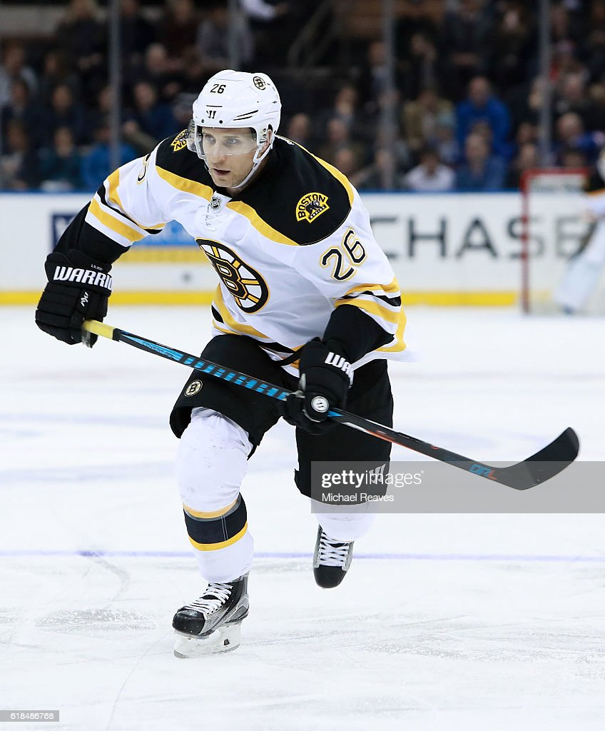 John-Michael Liles #26 of the Boston Bruins in action against the New York Rangers during the third period at Madison Square Garden on October 26, 2016 in New York City.