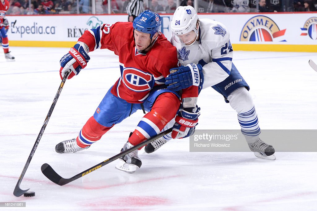 John-Michael Liles #24 of the Toronto Maple Leafs defends against <a gi-track='captionPersonalityLinkClicked' href=/galleries/search?phrase=Travis+Moen&family=editorial&specificpeople=208110 ng-click='$event.stopPropagation()'>Travis Moen</a> #32 of the Montreal Canadiens during the NHL game at the Bell Centre on February 9, 2013 in Montreal, Quebec, Canada. The Maple Leafs defeated the Canadiens 6-0.