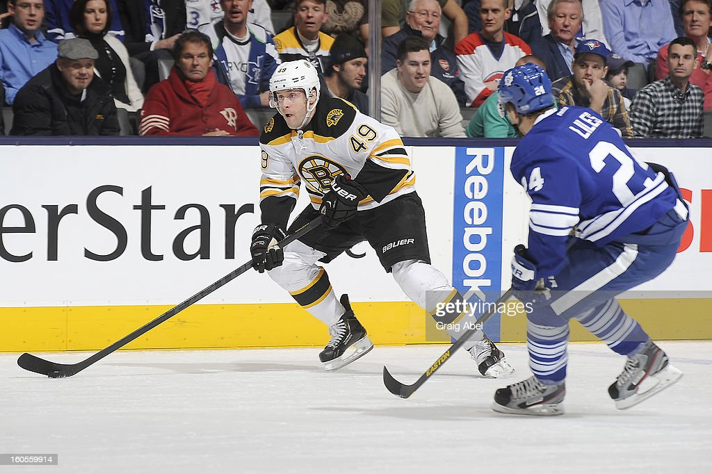 John-Michael Liles #24 of the Toronto Maple Leafs defends as Rich Peverley #49 of the Boston Bruins looks to pass the puck during NHL game action February 2, 2013 at the Air Canada Centre in Toronto, Ontario, Canada.