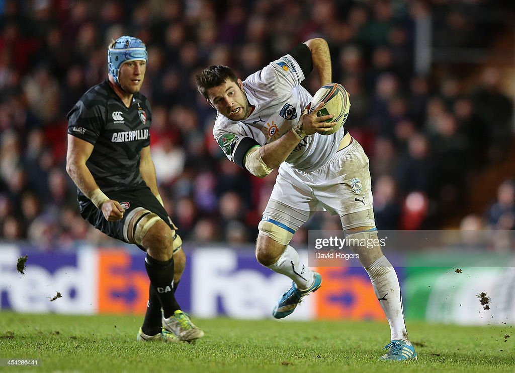 <a gi-track='captionPersonalityLinkClicked' href=/galleries/search?phrase=Johnnie+Beattie&family=editorial&specificpeople=4355668 ng-click='$event.stopPropagation()'>Johnnie Beattie</a> of Montpellier moves away with the ball as <a gi-track='captionPersonalityLinkClicked' href=/galleries/search?phrase=Jordan+Crane&family=editorial&specificpeople=561906 ng-click='$event.stopPropagation()'>Jordan Crane</a> looks on during the Heineken Cup match between Leicester Tigers and Montpellier at Welford Road on December 8, 2013 in Leicester, England.