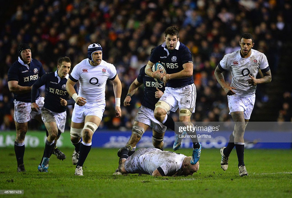 <a gi-track='captionPersonalityLinkClicked' href=/galleries/search?phrase=Johnnie+Beattie&family=editorial&specificpeople=4355668 ng-click='$event.stopPropagation()'>Johnnie Beattie</a> of Scotland jumps the tackle of Dan Cole of England during the RBS Six Nations match between Scotland and England at Murrayfield Stadium on February 8, 2014 in Edinburgh, Scotland.