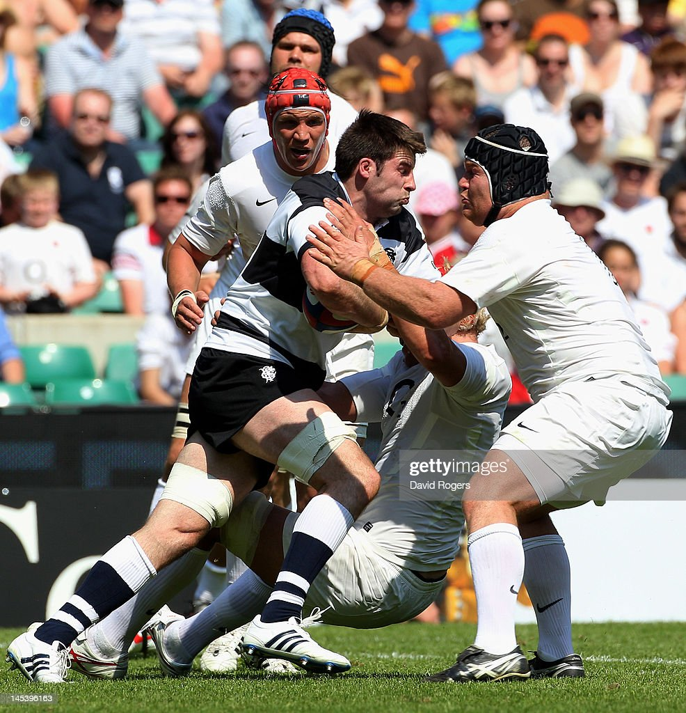 <a gi-track='captionPersonalityLinkClicked' href=/galleries/search?phrase=Johnnie+Beattie&family=editorial&specificpeople=4355668 ng-click='$event.stopPropagation()'>Johnnie Beattie</a> of The Barbarians is tackled by <a gi-track='captionPersonalityLinkClicked' href=/galleries/search?phrase=Matt+Stevens&family=editorial&specificpeople=209047 ng-click='$event.stopPropagation()'>Matt Stevens</a> of England during the Killik Cup match between England and The Barbarians at Twickenham Stadium on May 27, 2012 in London, England.