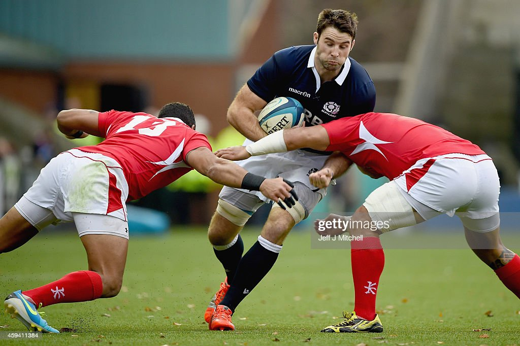 <a gi-track='captionPersonalityLinkClicked' href=/galleries/search?phrase=Johnnie+Beattie&family=editorial&specificpeople=4355668 ng-click='$event.stopPropagation()'>Johnnie Beattie</a>of Scotland is tackled by <a gi-track='captionPersonalityLinkClicked' href=/galleries/search?phrase=Nili+Latu&family=editorial&specificpeople=686673 ng-click='$event.stopPropagation()'>Nili Latu</a>and <a gi-track='captionPersonalityLinkClicked' href=/galleries/search?phrase=Siale+Piutau&family=editorial&specificpeople=2498975 ng-click='$event.stopPropagation()'>Siale Piutau</a> and Vungakoto Lilo of Tonga during the autumn test international match at Rugby Park on November 22, 2014 in Kilmarnock, Scotland.