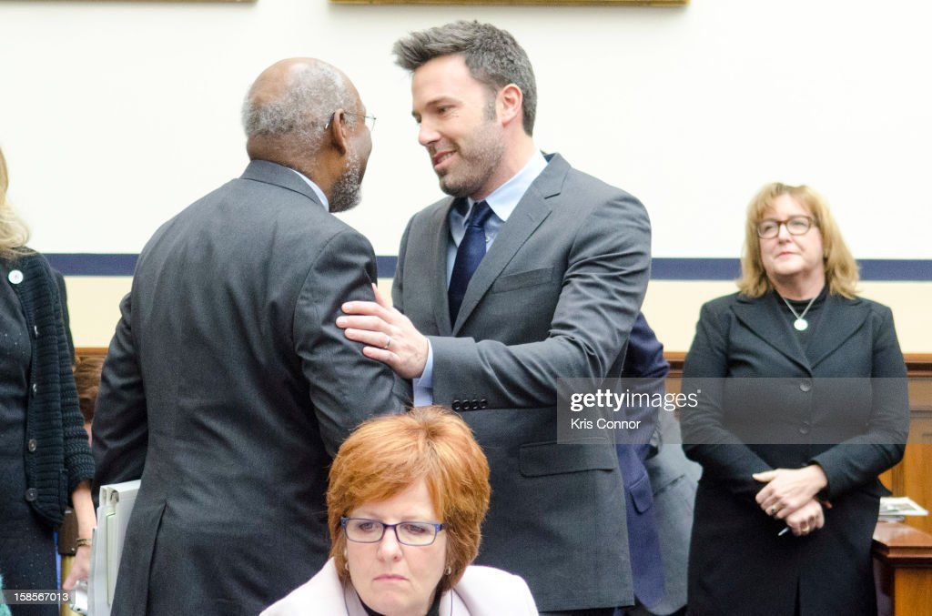 Johnnie Carson and <a gi-track='captionPersonalityLinkClicked' href=/galleries/search?phrase=Ben+Affleck&family=editorial&specificpeople=201856 ng-click='$event.stopPropagation()'>Ben Affleck</a> speak during a House Armed Services Committee hearing on the Evolving Security Situation in the Democratic Republic of the Congo and Implications for U.S. National Security at Rayburn House Office Building on December 19, 2012 in Washington, DC.
