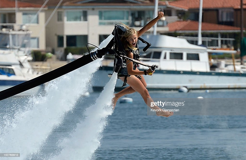 Johnnie Faye Carthwright, 20, a flight instructor assistant, demonstrates flying using a JetLev, a water-powered Jetpack flying machine in the Newport Beach harbor on September 25, 2012 in Newport Beach, California. Dean O'Malley, president of JetLev, will attempt to establish a new world record for flight of the JeLev by making a 26 mile open ocean crossing from Newport Beach to Avalon, Catalina Island on September, 29, 2012.