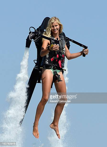 Johnnie Faye Carthwright a flight instructor assistant demonstrates flying using a JetLev a waterpowered Jetpack flying machine in the Newport Beach...