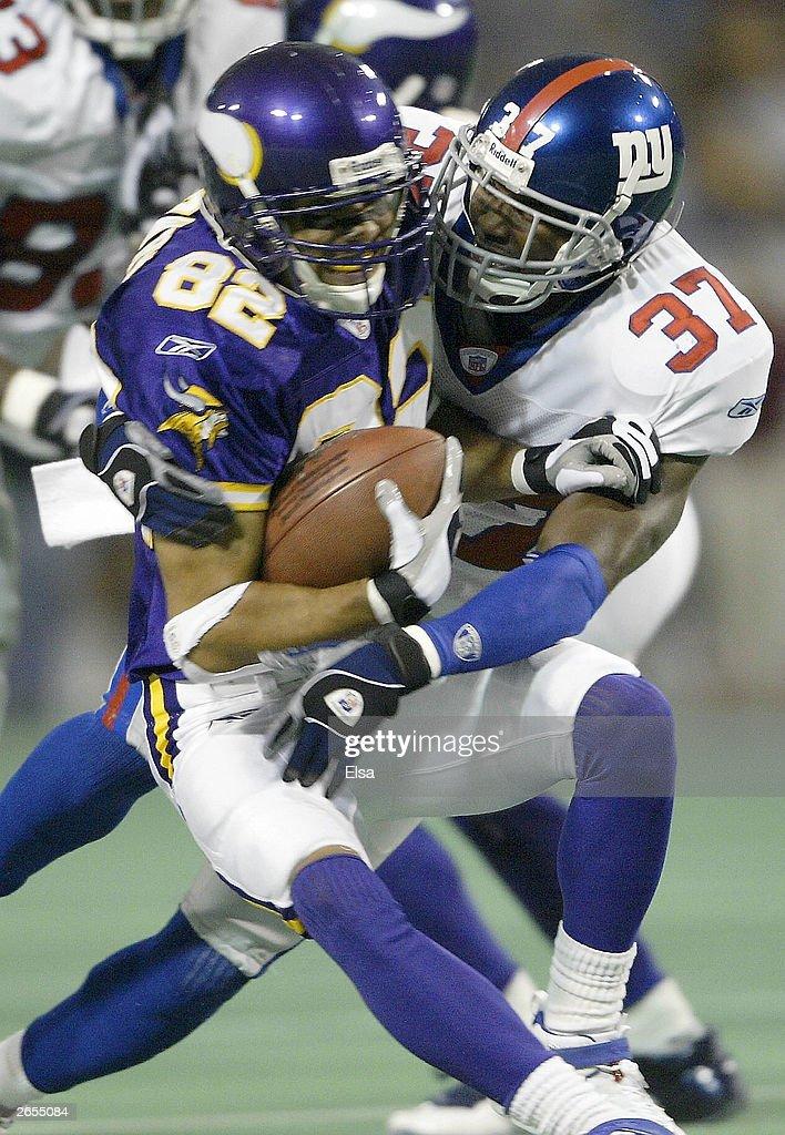 Johnnie Harris of the New York Giants brings down Keenan Howry of the Minnesota Vikings on October 26 2003 at the Hubert H Humphrey Metrodome in...